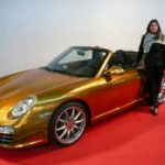 golden porsche with chrome spray